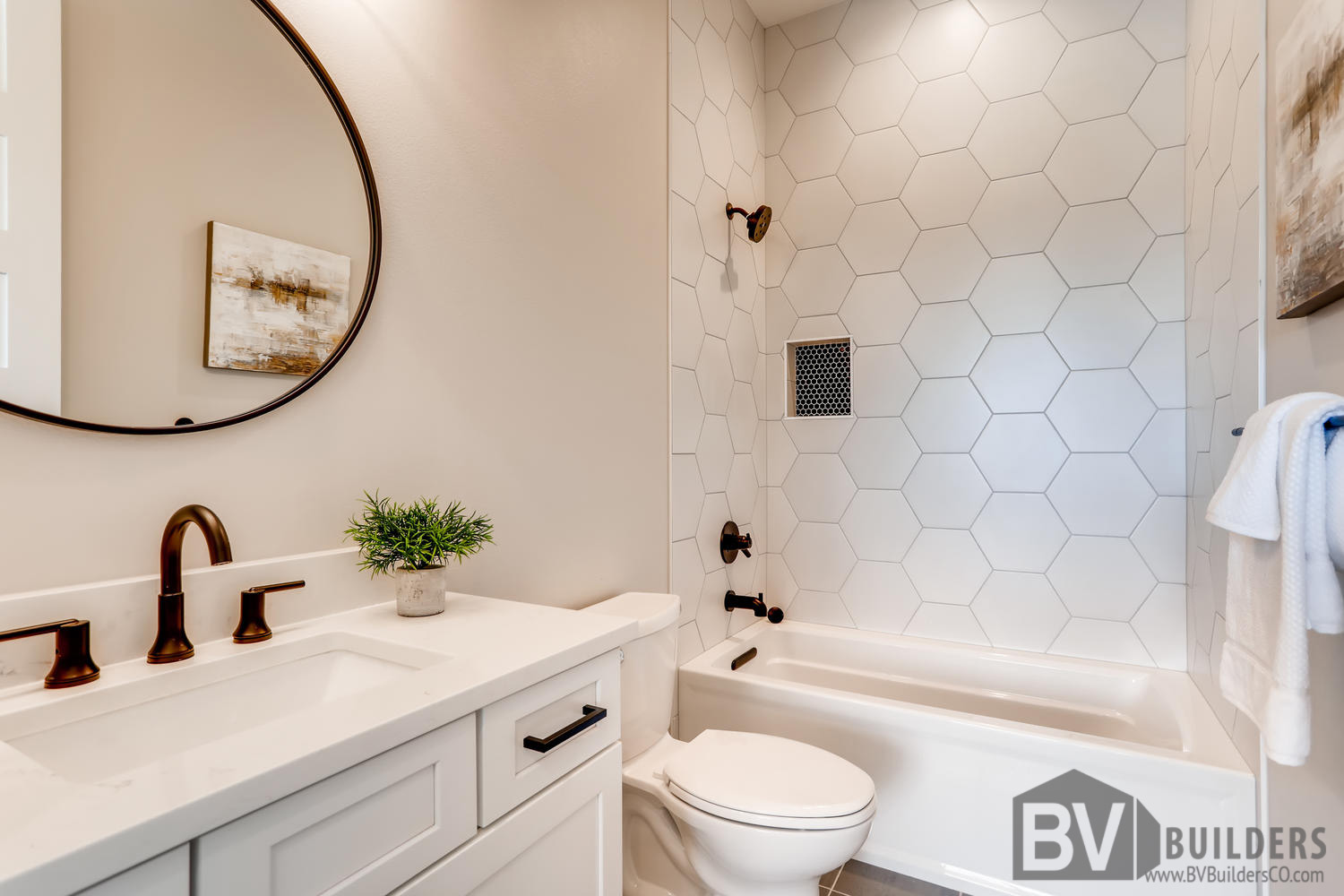 Full bathroom with marble hexagon tile and black penny tile niche