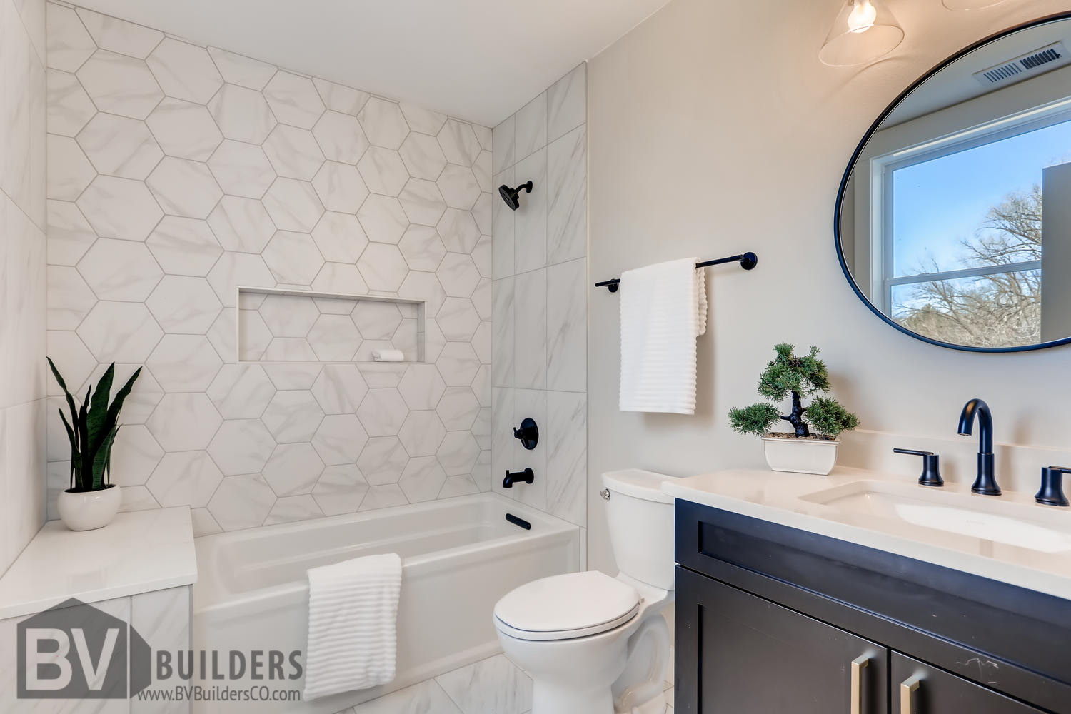 Bathroom with marble hexagon shower surround and recessed niche