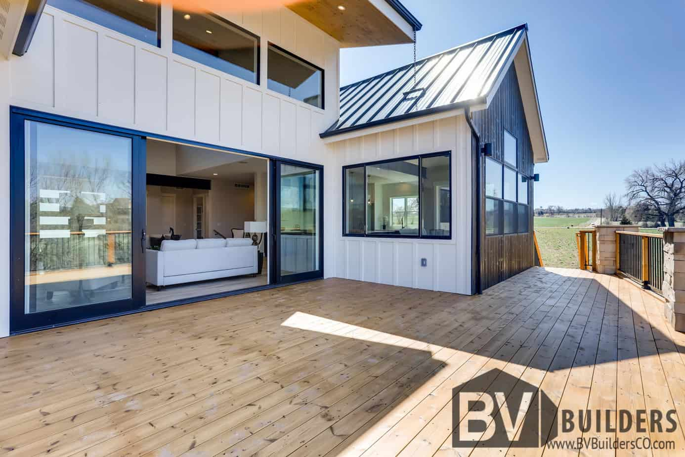Modern farmhouse with Thermory wood deck and large sliding glass door
