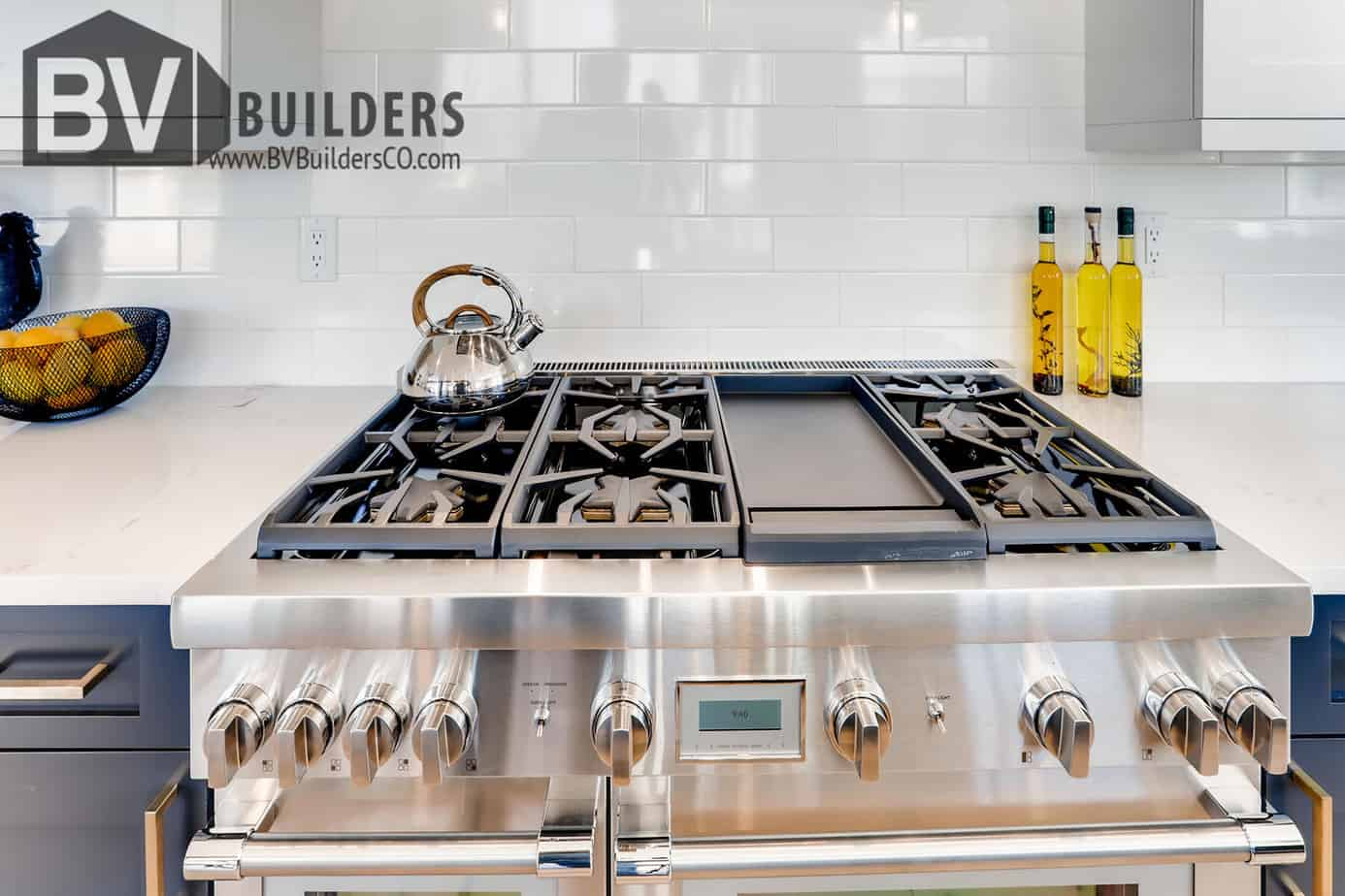 Thermador gas range with white subway tile backsplash