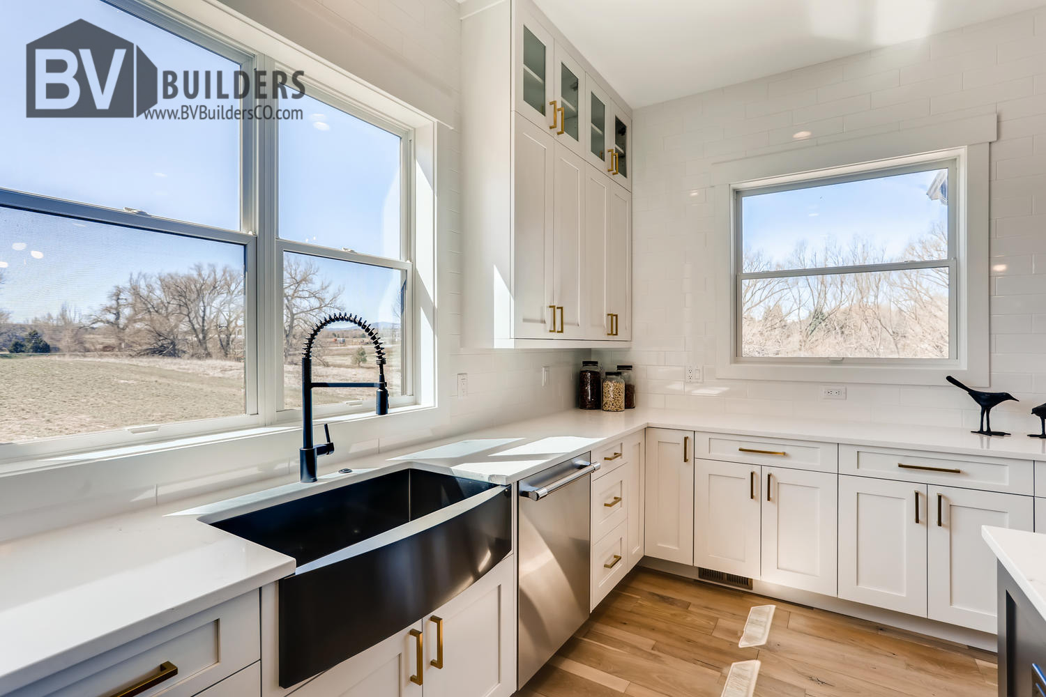 Modern farmhouse kitchen with farm sink and quartz countertops