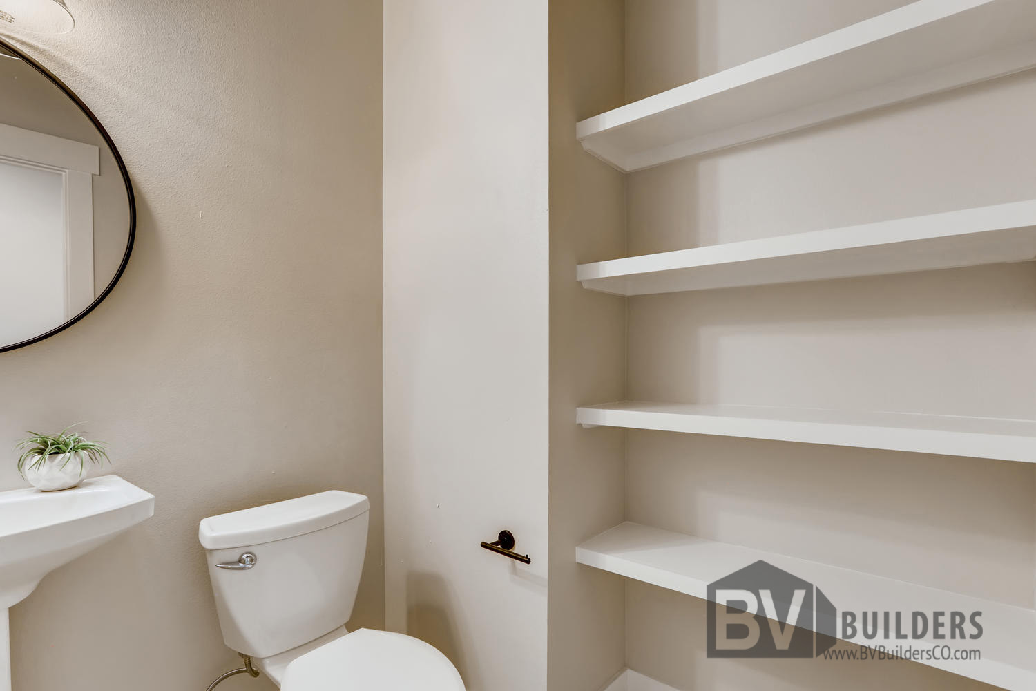 Powder room with built in shelves