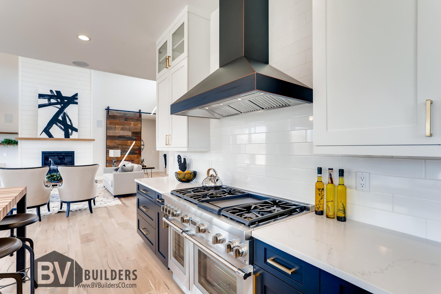 Modern farmhouse kitchen with Thermador range and white subway tile backsplash