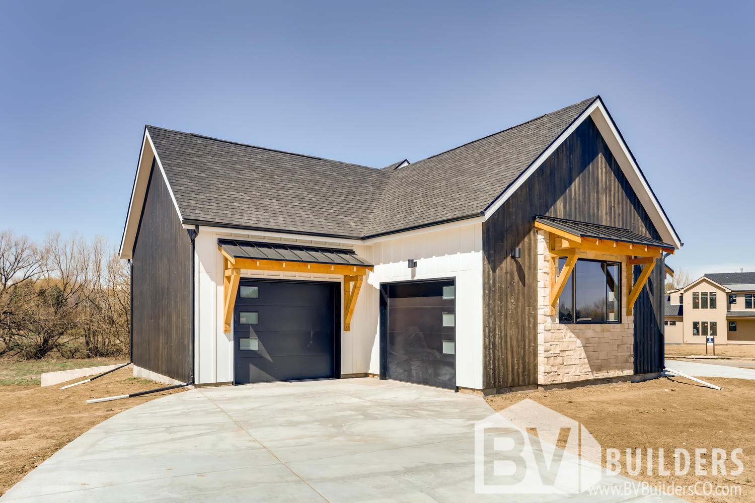 Modern farmhouse with vertical Thermory wood siding